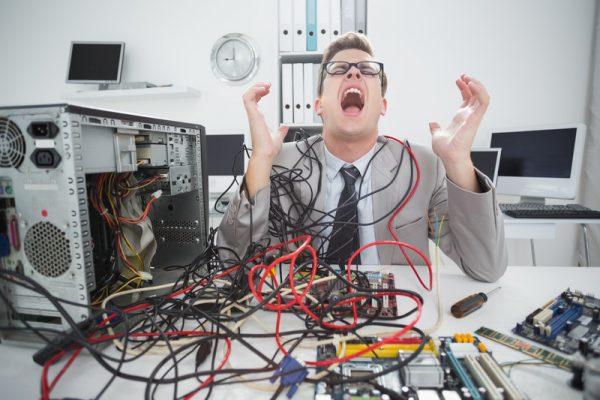 stressed computer repairman